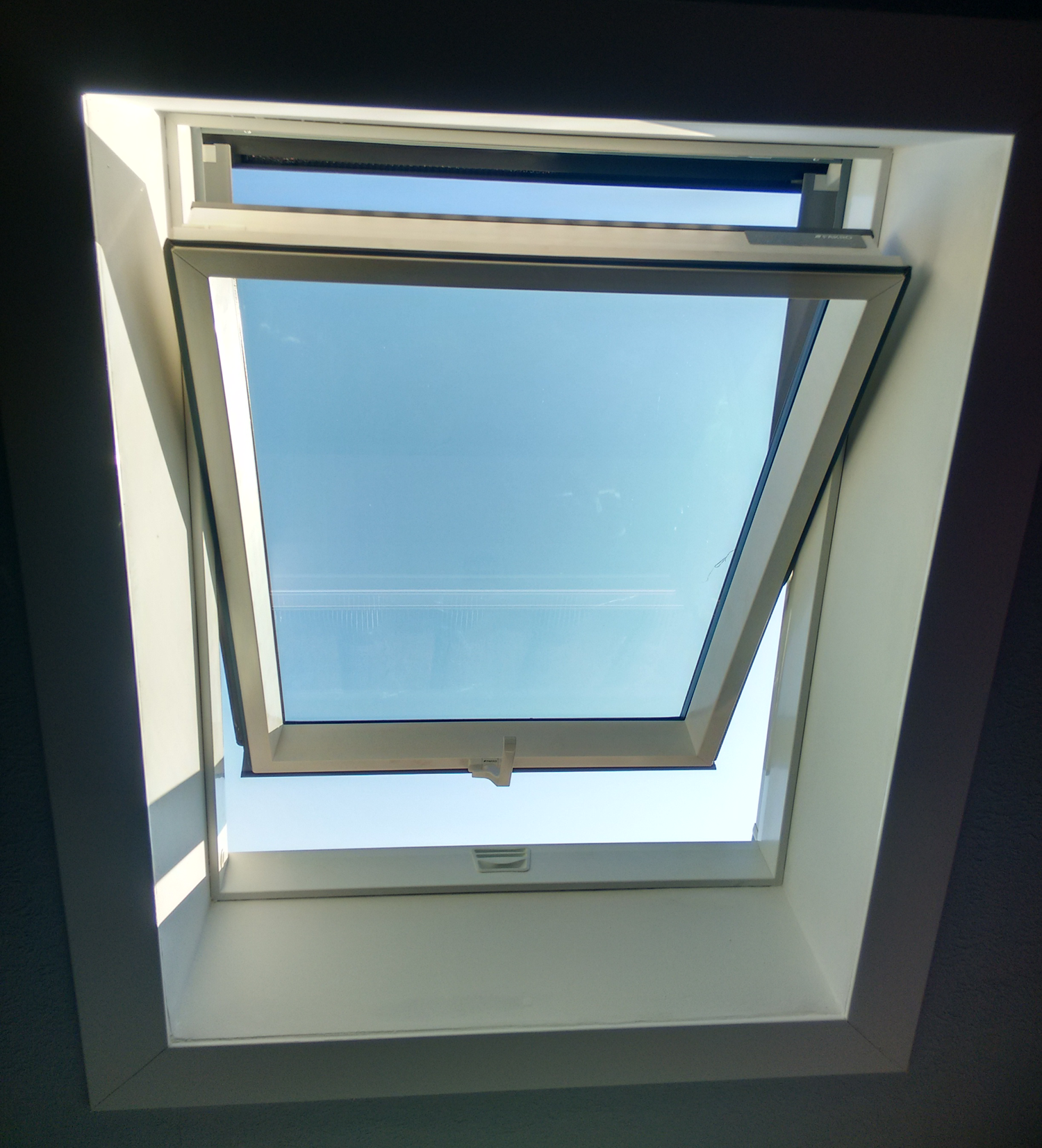 Internal shot of opened, PVC roof window